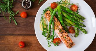Plate of asparagus, cherry tomatoes, and salmon